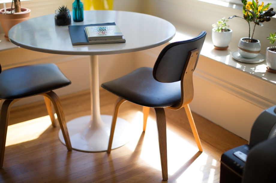 Small table and chairs, sunny office, relaxed environment